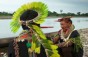 Cofan Indians from Dureno Community wearing traditional dress<br /> Atanacio Criollo &amp; Alejandro Criollo<br /> Agua Rico River near Dureno Amazon Rain Forest ECUADOR South America<br /> Crown made from Mealy (Amazon) Parrot feathers - (Amazona farinosa) Necklace of beads &amp; peccary teeth, arm bands of palm leaves and snake skin.<br /> This is the tribe who are fighting TEXACO oil company about damage done to their land from drilling and bad waste disposal