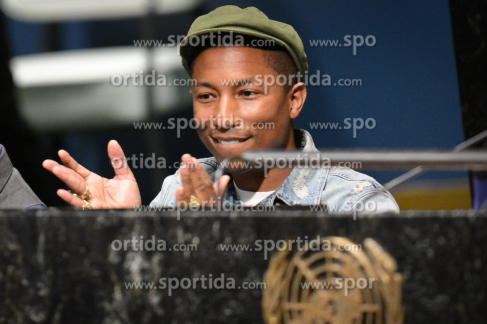 Singer Pharrell Williams applauds during an event marking the International Day of Happiness at the UN headquarters in New York, on March 20, 2015. Grammy-winning singer Pharrell Williams joined the United Nations to celebrate the International Day of Happiness on Friday, with an emphasis on reaching out to young people and move them to take action on climate change. EXPA Pictures &copy; 2015, PhotoCredit: EXPA/ Photoshot/ Niu Xiaolei<br /> <br /> *****ATTENTION - for AUT, SLO, CRO, SRB, BIH, MAZ only*****