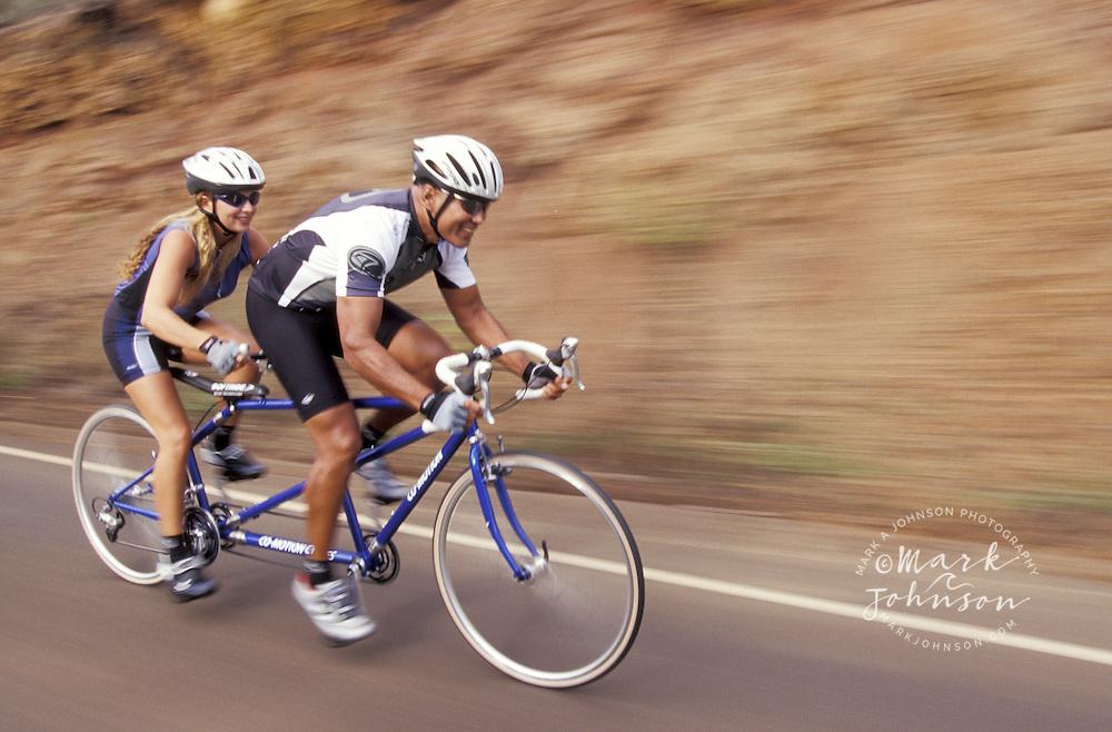USA, Hawaii, Kauai, couple riding tandem bicycle