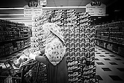 A woman who converted from christian to Muslim is seen in a supermarket.
