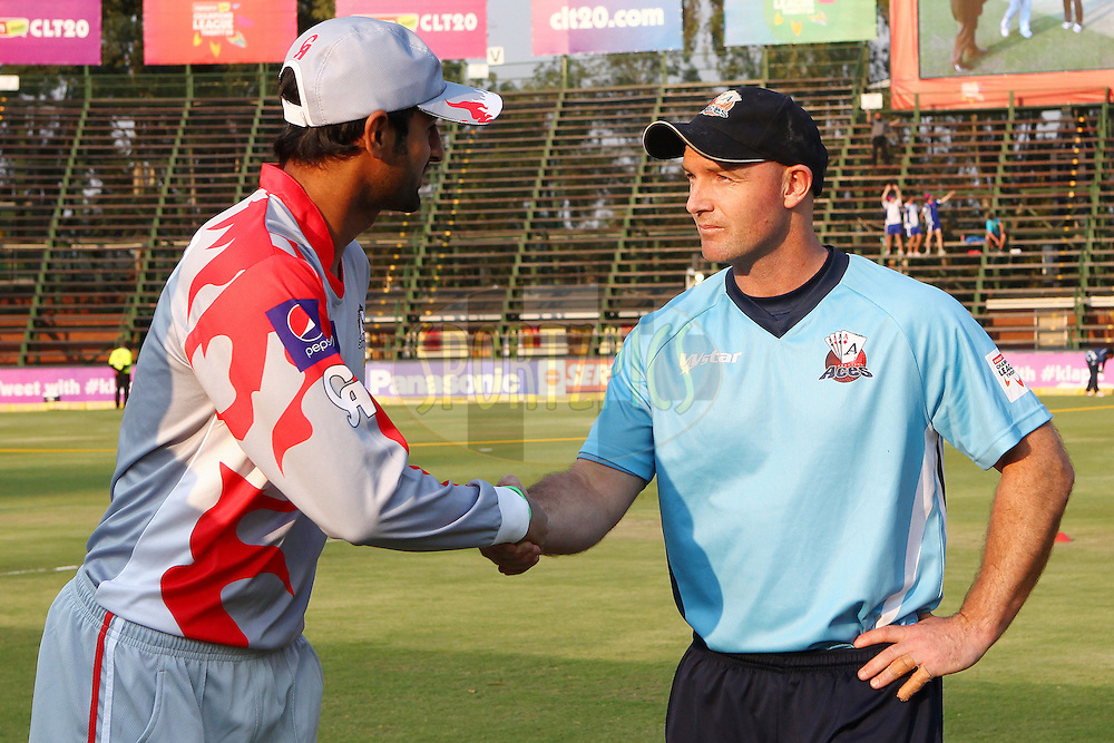 Gareth Hopkins (c) and Shoaib Malik (c) during the toss during 2nd Qualifying match of the Karbonn Smart CLT20 South Africa between Auckland Aces and Sialkot Stallions held at The Wanderers Stadium in Johannesburg, South Africa on the 9th October 2012..Photo by Ron Gaunt/SPORTZPICS/CLT20
