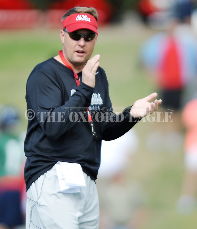 Head coach Hugh Freeze, in his first year as head coach, claps as Mississippi began spring practice in Oxford, Miss. on Friday, March 23, 2012. (AP Photo/Oxford Eagle, Bruce Newman)