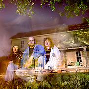 Photo by Gary Cosby Jr.  Amanda Kelsoe, Keith Duncan and Denise Duncan pose in front of an old house near Moulton that they are investigating for paranormal activity.