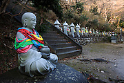 TOYAMA MEDICINE.Budha holding a medicine pot at Gohyaku-rakan (500 acheivers of nirvana) in Toyama's Chokenji temple. .Chokeiji Temple is situated in Kureha Hills in the suburbs of Toyama City. 500 stone disciples of Buddha are placed side by side quietly on the eastern hillside of the temple. Some of them are standing, and others are sitting. It is said that none of them has the same expression. This area is noted for its cherry blossoms in spring and the colored leaves in fall, which attract many tourists every year..Toyama prefecture is located near the center of Japan and is approximatelythe same distance from the three largest cities in Japan-Tokyo,Nagoya,andOsaka. Toyama's pharmaceutical tradition has a more than 300 years history. As it is located on the Japan sea, it is facing China and has been an importer of traditional Chinese medicine knowledge which it developed through the years. There are now approximately 100 manufactures and over 100 factories in Toyama in terms of pharmaceutical products and Toyama prefecture acquires a steady reputation as Japan's medicine manufacturing base.
