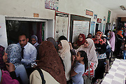 Egyptian women wait in cue for their turn to cast a ballot during the historic first, truly democratic Presidential election May 23, 2012 in Cairo Egypt. Coming 15 months after the revolution that toppled the regime of former President Hosni Mubarak, the election will not only decide the leader of the country, but also set the tone and decide the course by which the country moves forward in democracy and reform.  (Photo by Scott Nelson)