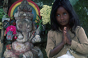 Girl beside Ganesh shrine at Agrapatana.