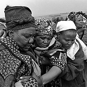 Community members and family from the farms and nearby Ficksburg town in the eastern Free State attend the wake and funeral of a young woman who succumbed to Aids 2002. Photo Leonie Marinovich