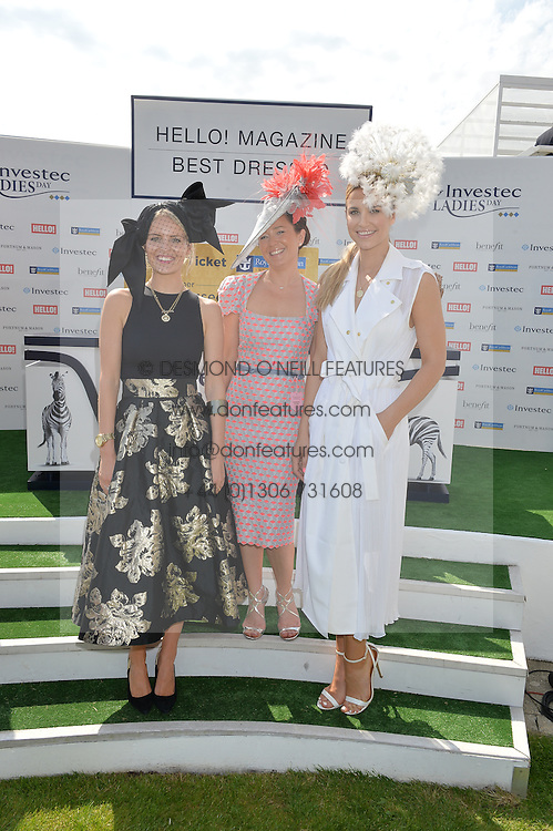 Left to right, ALEXANDRA LIGHT, winner of Best Dressed LEIGH JOHNSON and VOGUE WILLIAMS at the Investec Ladies Day at the Investec Derby Festival 2015 at Epsom Racecourse, Epsom, Surrey on 5th June 2015.