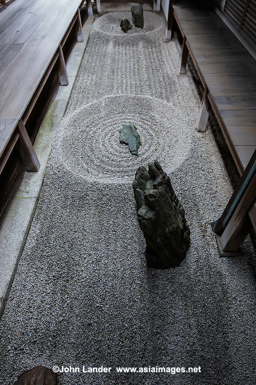 Totekiko is a tiny garden tucked between temple buildings.  It is said to be the smallest of this type.  The meaning of this garden is physical.  It shows that a heavier stone creates stronger ripples on the water surface.  Pure and simple.