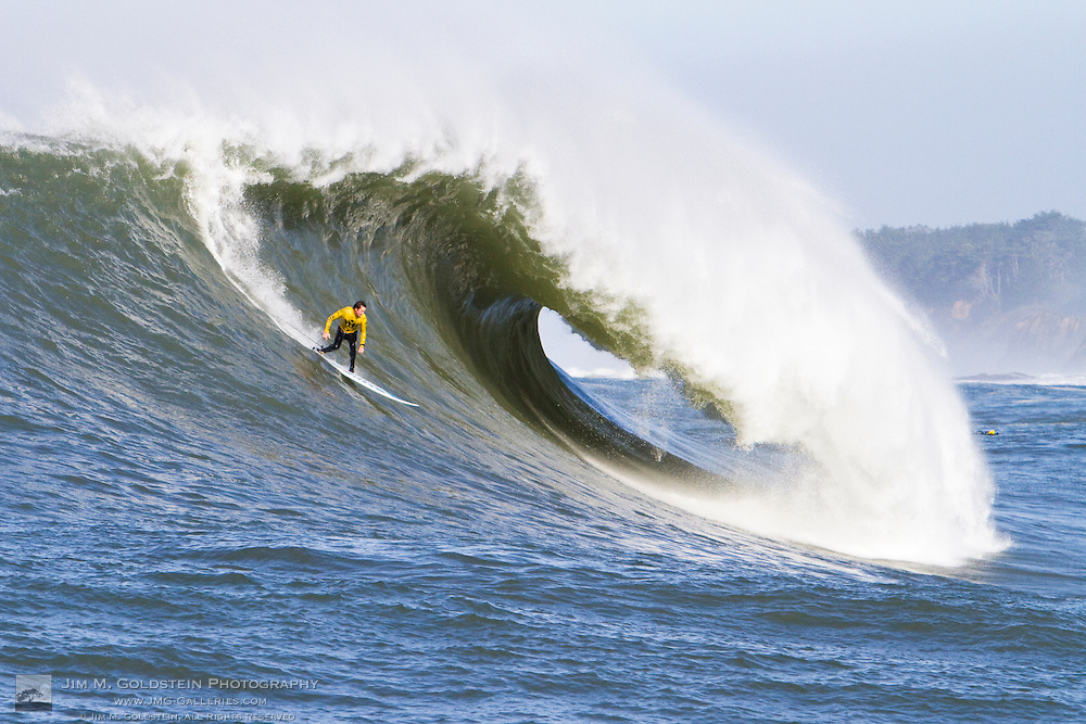 """Kenny """"Skindog Collins drops into a huge wave at the 2010 Mavericks Surf Contest held in Half Moon Bay, California on February 13, 2010"""