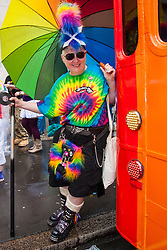 London, June 28th 2014. A Scottish woman poses as Gay Pride revellers assemble on Baker Street ahead of the parade.
