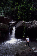 Tourist diving on a waterfall in Kuna Yala region in Panama. This region is also know as San Blas and is governed by the Kuna tribe.