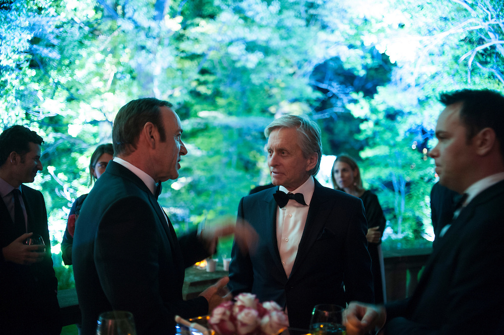 Photo by Matt Roth.Assignment ID: 30141809A..Kevin Spacey, left, talks with Michael Douglas during the Vanity Fair Bloomberg White House Correspondence Dinner After Party at the Official Residence of the French Ambassador Washington, D.C. on Saturday, April 27, 2013.