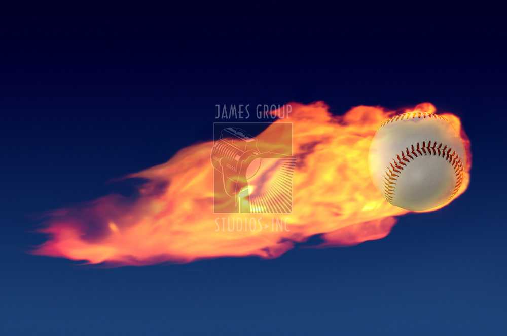 Flaming baseball shooting through a night sky like a comet with a tail of fire