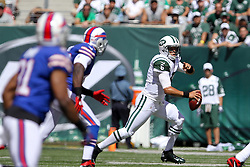 Sept 9, 2012; East Rutherford, NJ, USA; New York Jets quarterback Mark Sanchez (6) runs with the ball during the first half at MetLIfe Stadium.