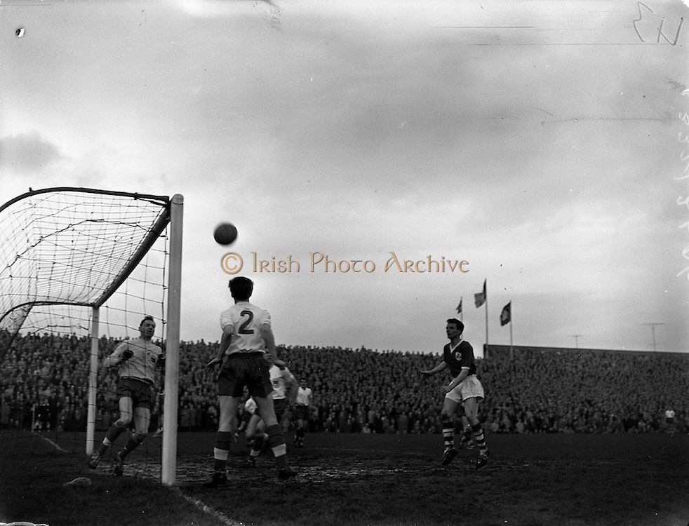 13/03/1960<br /> 03/13/1960<br /> 13 March 1960<br /> Soccer Amateur International: Ireland v Great Britain at Dalymount Park, Dublin. Britain's full back Thompson (No.2) heads this ball clear during a dangerous Irish attack, watched by Carroll (Ireland) right, and goalie M. Pinner.