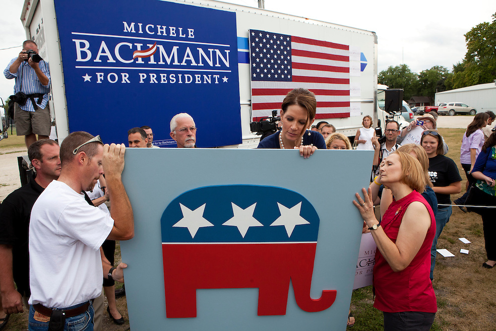 Republican presidential hopeful Michele Bachmann signs the back of a panel during a campaign stop on Tuesday, August 9, 2011 in Humboldt, IA.