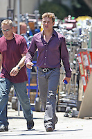"July 13th, 2010 Los Angeles, CA. ***EXCLUSIVE*** Ryan Phillippe arrives on to the set of ""The Lincoln Lawyer"" with what appears to be a wardrobe malfunction with the fly of his pants which kept flapping open as he walked. Wardrobe department personnel were later seen adjusting Ryan's trousers before he filmed a scene inside an apartment building. Ryan Phillippe co stars with Matthew McConaughey in ""The Lincoln Lawyer"" about a lawyer who conducts business from the back of his Lincoln town car .Photo by Eric Ford/On Location News 818-613-3955 info@onlocationnews.com"