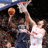 15 July 2012: Mickael Gelabale of Team France goes for the layup past Pau Gasol of Team Spain during a pre-Olympic exhibition game won 75-70 by Spain over France, at the Palais Omnisports de Paris Bercy, in Paris, France.