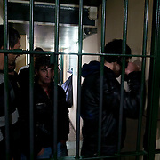 Illegal immigrants are held in the main police headquarters in Lesvos until they are checked and processed.
