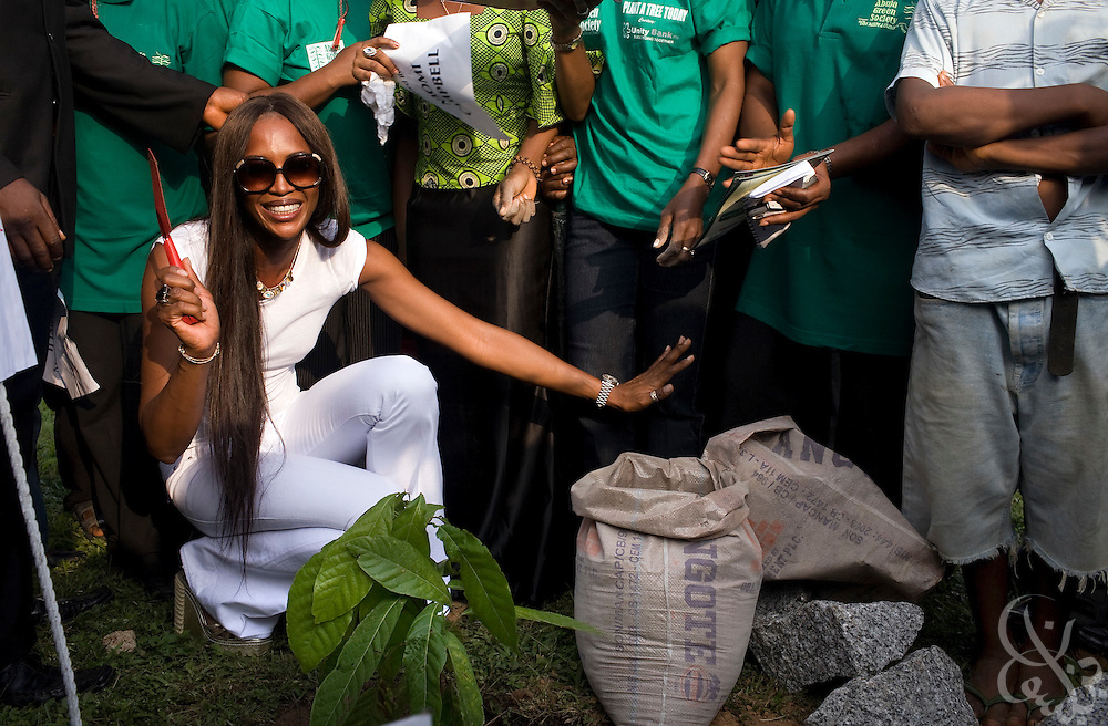 """Super model Naomi Campbell plants a cocoa tree at a ceremony in association with the 3rd annual ThisDay festival July 11, 2008 in Abuja, Nigeria. The ThisDay festival, themed """"Africa Rising"""", is an effort to raise awareness of African issues and promote positive images of Africa using music, fashion and culture.."""