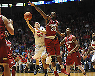 "Mississippi's Marshall Henderson (22) has his shot blocked by Arkansas'  Marshawn Powell (33) at the C.M. ""Tad"" Smith Coliseum on Saturday, January 19, 2013. (AP Photo/Oxford Eagle, Bruce Newman)"