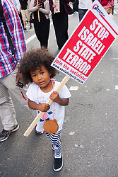 London, August 9th 2014. A child carries a placard as tens of thousands of pro-Palestine demonstrators march from the BBC headquarters to Hyde Park