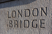 carved letters reading london bridge in stone