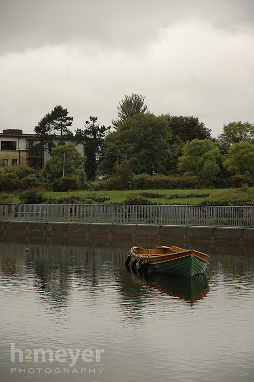 A lone boat in the River Corrib,  Galway Ireland on a stormy afternoon.