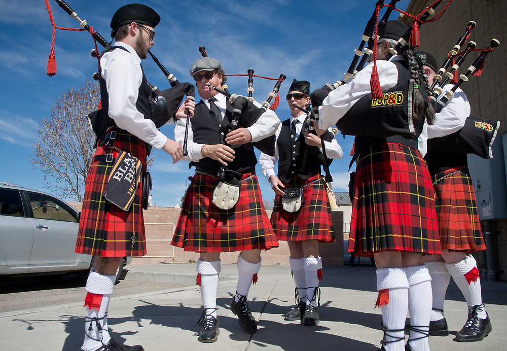 "mkb031617a/metro/Marla Brose --  Bagpipers from  High Desert Pipes and Drums, including, Neil Wallace, left, Pipe Major Bill Horn, second from left, and Pipe Sgt. Lorraine McInnes, third from left, warm up outside of O'Niell's on Juan Tabo, before playing a lunchtime set, Friday, March 17, 2017, in Albuquerque, N.M. ""What's St. Patrick's Day with out bagpipes?"" asked Horn, who explained that the band had ten performances scheduled throughout the day. ""We have a huge Celtic community. They come out of the woodwork to watch us play,"" Horn said. (Marla Brose/Albuquerque Journal)"