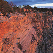 Photograph of reflective light striking the rock wall at Mohave Point at Grand Canyon National Park, Arizona.