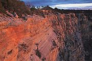 Photograph of reflective light striking the rock wall at Mohave Point at Grand Canyon National Park, Arizona.