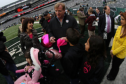 Oct 28, 2012; East Rutherford, NJ, USA; NFL Commissioner Roger Goodell signs a pink penalty flag for Dante Cano before the game between the New York Jets and the Miami Dolphins at MetLIfe Stadium.