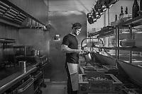 Lead line cook Ryan Raternostro in the kitchen of the Restaurant, Jole, Calistoga, California