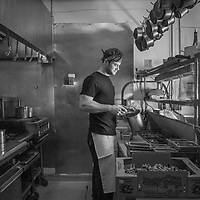 Lead line cook Ryan Raternostro in the kitchen of the Restaurant, Jole, Calistoga, California