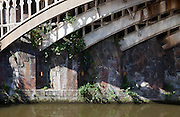 A skewed railway bridge over a canal in Manchester, England