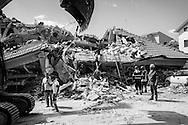 A devastating earthquake struck central Italy on Wednesday (August 24, 2016), killing at least 290 people. The magnitude-6.2 quake struck at 03:36 (01:36 GMT), 100km (65 miles) north-east of Rome, near Accumoli. <br /> In the small Italian town of Amatrice hit hard by a magnitude-6.2 earthquake that struck in the middle of the night, locals and rescuers uninterruptedly dug through the rubble of downed homes and apartments looking for survivors. Rescue efforts also turn to body retrieval as aftershocks continue in Amatrice.
