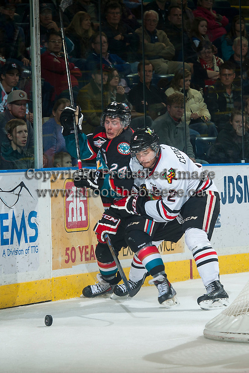 KELOWNA, CANADA - NOVEMBER 22: Anton Cederholm #2 of Portland Winterhawks checks Tyson Baillie #24 of Kelowna Rockets during the third period on November 22, 2014 at Prospera Place in Kelowna, British Columbia, Canada.  (Photo by Marissa Baecker/Shoot the Breeze)  *** Local Caption *** Anton Cederholm; Tyson Baillie;