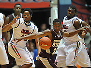 "Mississippi State's Deville Smith (33) comes up with a loose ball in front of Mississippi's Jelan Kendrick (45) and Mississippi's Nick Williams (20) at the C.M. ""Tad"" Smith Coliseum in Oxford, Miss. on Wednesday, January 18, 2012. (AP Photo/Oxford Eagle, Bruce Newman)."