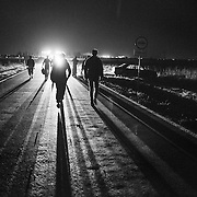 Refugees walk in the night after crossing the border between Serbia and Croatia to make their way to the makeshift camp near Tovarnik train station, Croatia.<br />