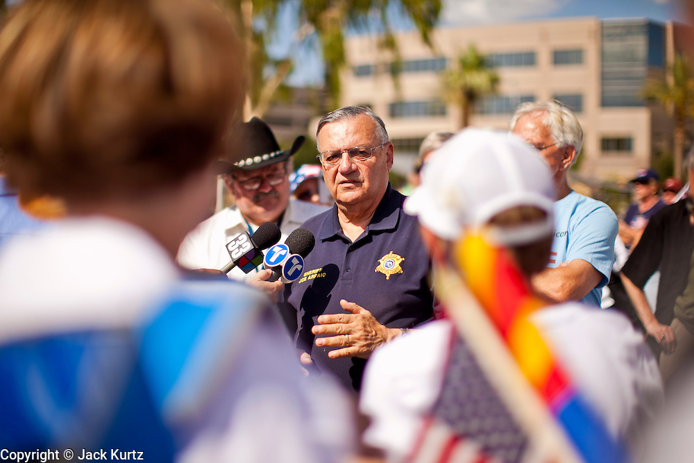 12 JUNE 2010 - PHOENIX, AZ: Maricopa County Sheriff Joe Arpaio talks to supporters at a Tea Party rally in support of Arizona bill SB 1070 in Phoenix, AZ, Saturday. About 500 people, many from California and Florida, came to Bolin Memorial Park in Phoenix Saturday. The pro SB 1070 rally was sponsored by Tea Party.   PHOTO BY JACK KURTZ