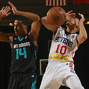 Delaware 87ers Guard MIKH MCKINNEY (10) battles Greensboro Swarm Guard RALSTON TURNER (14) for the rebound in the first half of an NBA D-league regular season game between the Delaware 87ers and the Greensboro Swarm (Charlotte Hornets) Wednesday, March 29, 2017, at The Bob Carpenter Sports Convocation Center in Newark, DEL