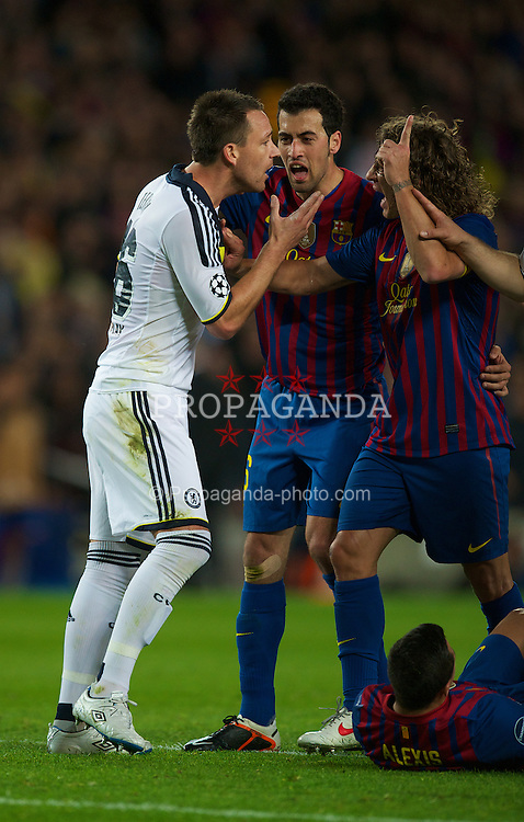 BARCELONA, SPAIN - Tuesday, April 24, 2012: Chelsea captain John Terry argues with FC Barcelona Carles Puyol and Sergio Busquets after being shown the red card and sent off for kicking FC Barcelona's Alexis Sanchez during the UEFA Champions League Semi-Final 2nd Leg match at the Camp Nou. (Pic by David Rawcliffe/Propaganda)