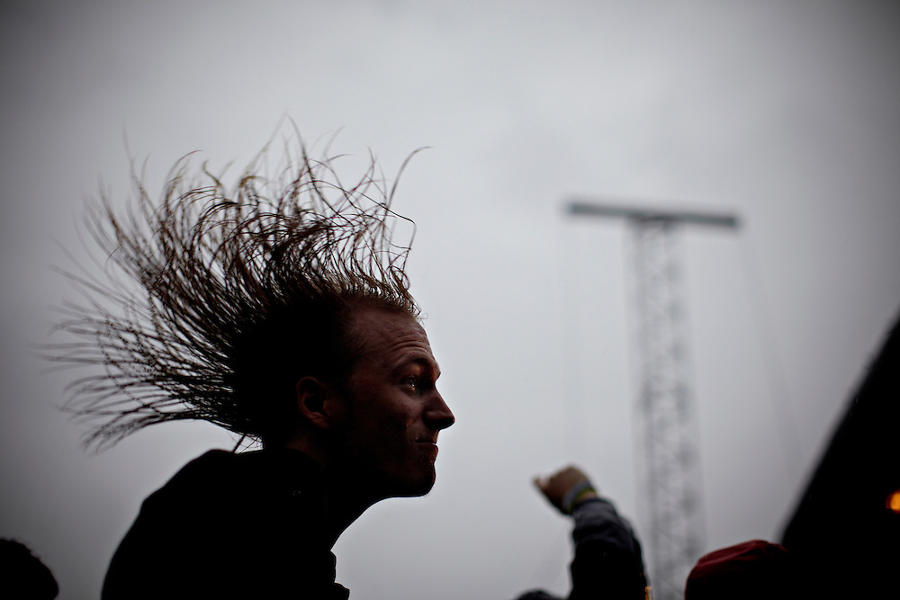 A fan is headbanging during the Sense Absense (NO) concert..The 7th annual Slottsfjellfestival is taking place over the course of three days in Tønsberg with about 10.000 visitors each of the three days...Norway is probably the country in the world with the highest rate of festivals with between 5-600 festivals every year in relation to the about 4.7 million inhabitants...Photo by: Eivind H. Natvig/MOMENT