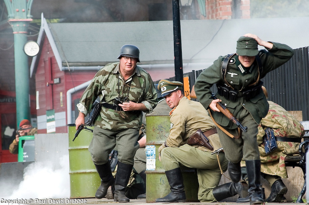Reenactors portraying panzer grenadiers of the Gro&szlig;deutschland Division take part in a battle reenactment during the Elsecar 1940's Weekend at Elsecar Heritage Centre 4 September 2010<br /> Images &copy; Paul David Drabble