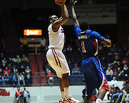 "Ole Miss' Dundrecous Nelson (5) shoots over SMU's Ryan Manuel (1) at the C.M. ""Tad"" Smith Coliseum in Oxford, Miss. on Tuesday, January 3, 2012. Ole Miss won 50-48."