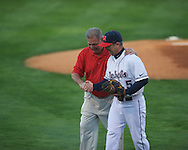 Former Ole Miss coach and two sport All-American Jake Gibbs and current head coach Mike Bianco walk off the field at Ole Miss vs. Alabama at Oxford-University Stadium in Oxford, Miss. on Friday, April 12, 2013. Ole Miss won 6-0 to snap a 6 game losing streak.