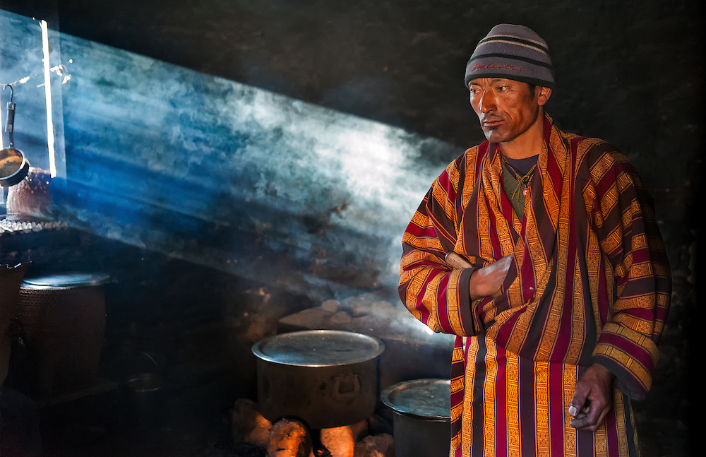 A man in a kitchen in Bumthang Bhutan.