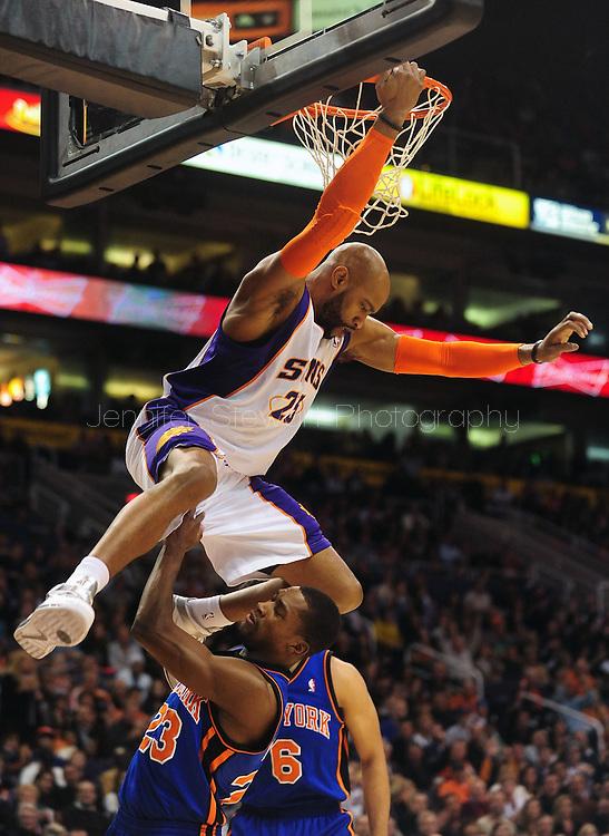 Jan. 7 2011; Phoenix, AZ, USA; Phoenix Suns guard Vince Cater (25) dunks over New York Knicks guard Toney Douglas (23) during the first half at the US Airways Center. Mandatory Credit: Jennifer Stewart-US PRESSWIRE.