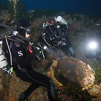 Underwater photographers Tony Wu and Eric Cheng set up Canon 5D Mark II cameras to capture flashlight fish at night on a shipwreck in Papua New Guinea. Photo: Matt Segal (Please contact Matt if you are interested in licensing any of the behind-the-scenes pictures: http://carbonos.com)